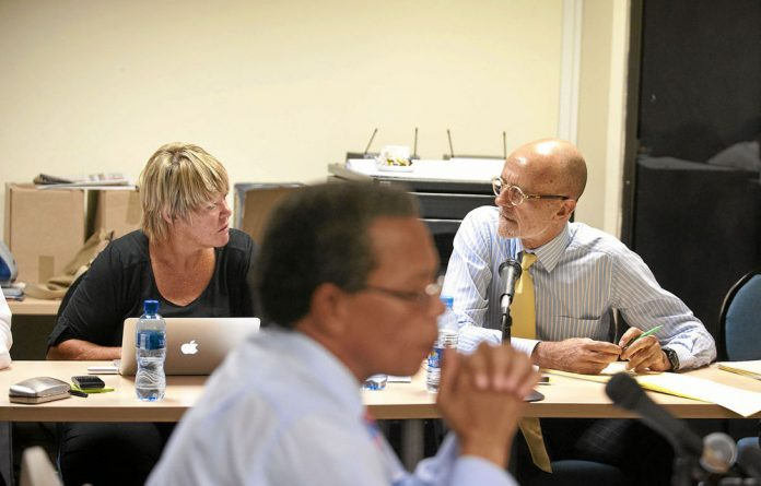 Glynnis Breytenbach and advocate Wim Trengove confer while the NPA's Lawrence Mrwebi looks on.