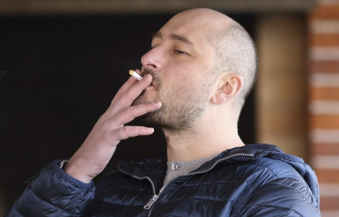 Russian journalist Babchenko smokes a cigarette during an interview in Kiev.