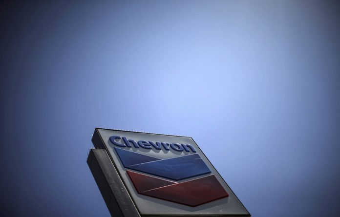 Pay where you earn: The multinational fuel giant Chevron has been asked to appear before the OECD for arbitration in a dispute about where it pays tax.