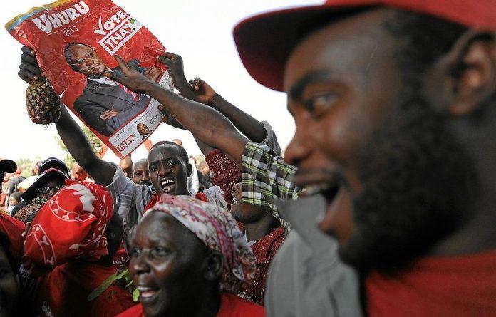 Supporters of Kenyan President Uhuru Kenyatta