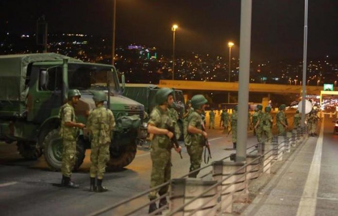 Turkish soldiers stand guard on the country's Bosphorus Bridge during a coup attempt.