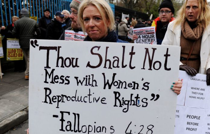 A protester displays a banner against Ireland's abortion laws during a march in Dublin