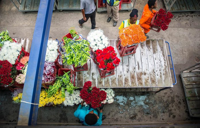 Employees prepare for a flower auction at the Multiflora flower market in Jeppe