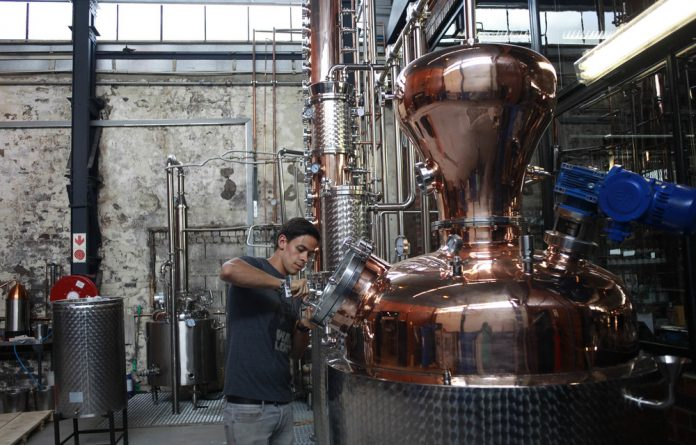 Artisanal: Distiller Jacques Celliers checks the process at the Ginologist Craft Link Distillery. Photo: Oupa Nkosi