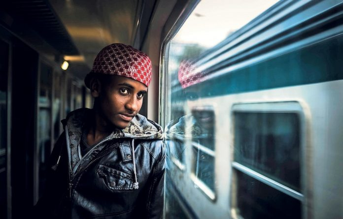 Escape route: Meron from Eritrea looks out of the window of a train from Rome to bozen