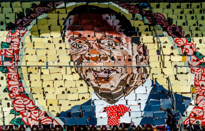 High hopes: People use boards to make a portrait of President Emmerson Mnangagwa at Independence Day celebrations. Zanu-PF's manifesto