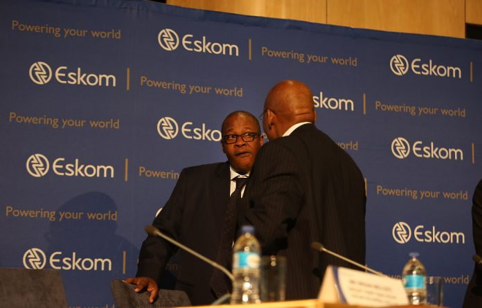 Brian Molefe is comforted by Ben Ngubane after he broke down while talking about his relationship with the Guptas during a media conference in November 3.