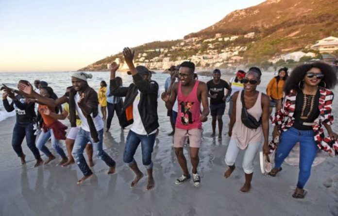 Members of the Black People's National Crisis Committee protest on Clifton's Fourth Beach after allegations that a private security company closed the beach.