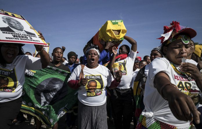 Dead and buried: IFP members celebrate their comprehensive victory over the ANC in Nquthu.