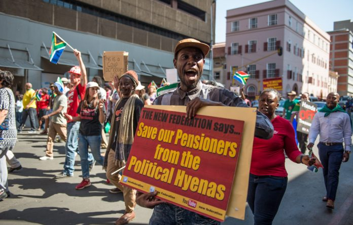 Ethics under fire: Protesters demonstrate against CPS and Net1 selling life insurance policies to social grant recipients. The high court has effectively deemed such debit orders legal.