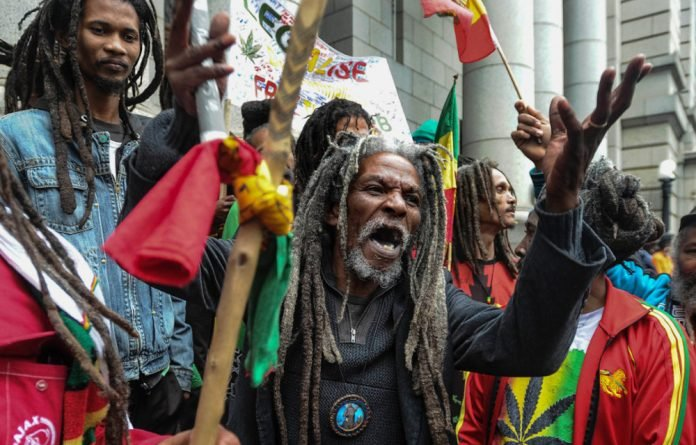 Rastafarians and activist celebrate outside the Western Cape High Court after the court allowed for the possession