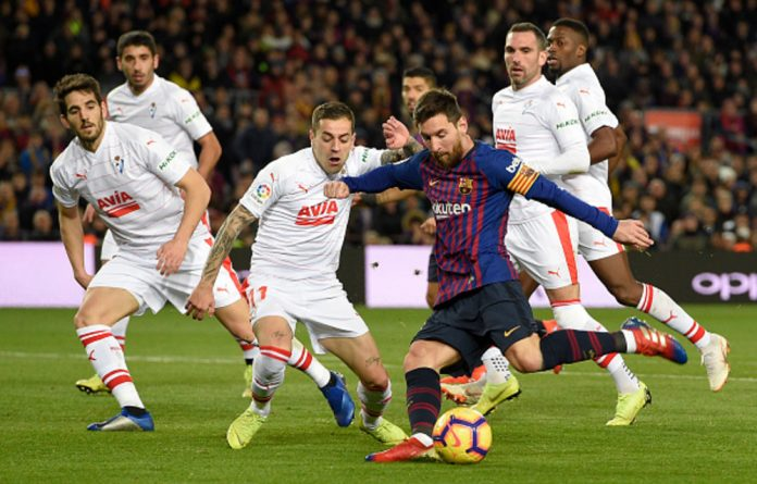 Barcelona's Lionel Messi shoots to score his team's second goal during the football match between FC Barcelona and SD Eibar at the Camp Nou stadium in Barcelona.