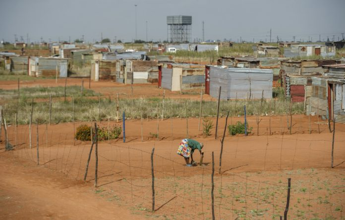 Burden: Women and girls in South Africa bear the brunt of the hardships wrought by poverty. Photo: Delwyn Verasamy