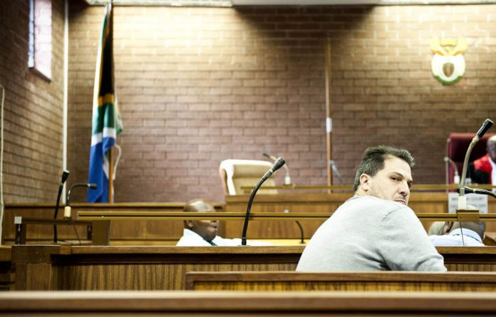 There's money in metal: Scrap dealer Neil Davies at his bail hearing on Thursday after he was arrested allegedly in possession of R100 000 worth stolen copper.
