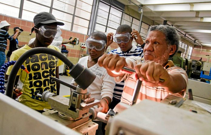 Practical: Students at the technical and vocational college in central Johannesburg attend a mechanics class.