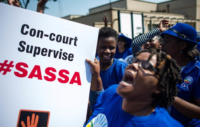 DA members at the Constitutional Court during a hearing on Black Sash's request for Sassa to use Cash Paymaster Services until a new grant payment system was in place.