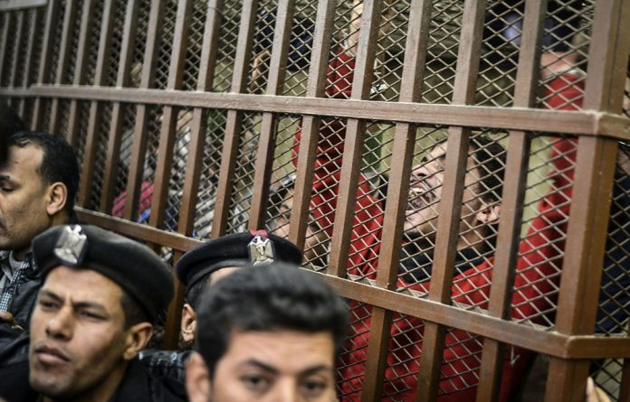 Defendants at a Cairo court after the acquittal on January 12 2015 of 26 men accused of 'debauchery'
