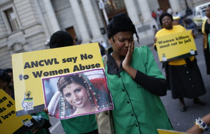 Members of the ANC Women's League protest outside the South African court where British businessman Shrien Dewani faced charges of murdering his Swedish bride. He was acquitted.