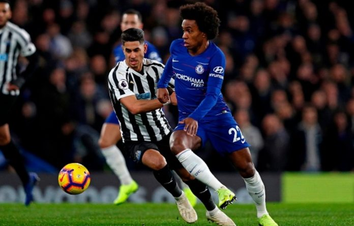 Chelsea midfielder Willian vies with Newcastle United striker Ayoze Perez during the English Premier League football match between Chelsea and Newcastle United at Stamford Bridge in London on January 12 2019.