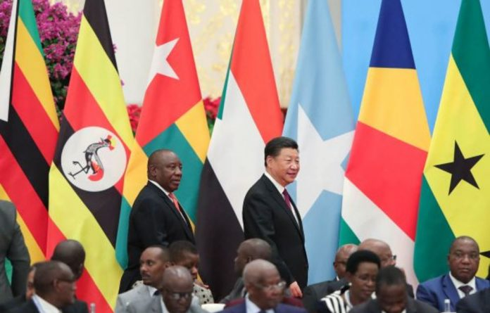 Doing deals: China's President Xi Jinping and President Cyril Ramaphosa met at the Forum on China-Africa Co-operation earlier this month.