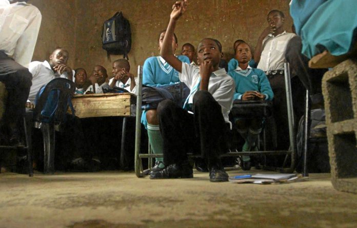 Bright future: This classroom is a step up from being taught under a tree