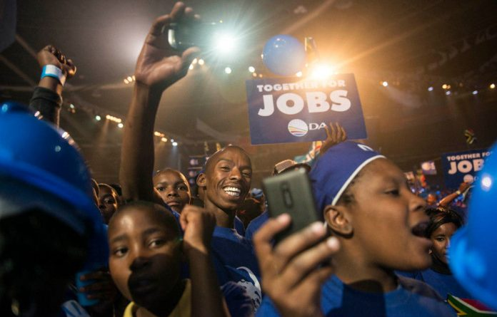 Black DA supporters cheer at the final election rally in Johannesburg.