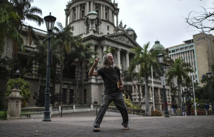 Preacher man: Gavin Mitchell delivers his sermons in front of City Hall