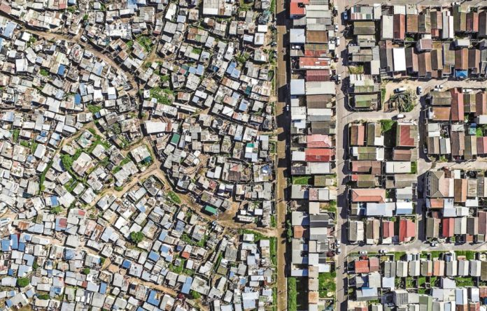 Johnny Miller used a drone to take the aerial photographs that highlight the close proximity of poverty and wealth in places like Vukuzenzele and Sweet Home Farm in the Western Cape.