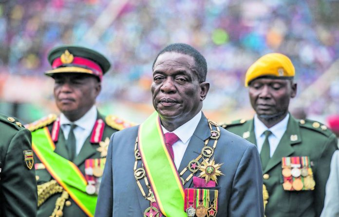 Takeover: Emmerson Mnangagwa promised much at his inauguration but didn't mention military control.