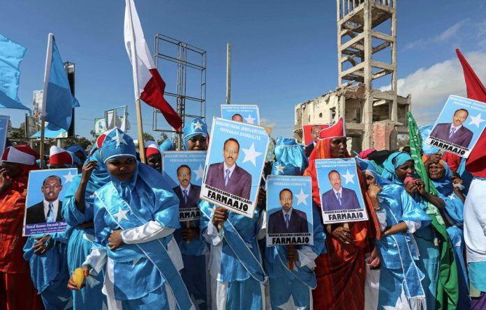 Somali women celebrate the election of Mohamed Abdullahi Mohamed as president — but the expectations of him to deal with the troubles that bedevil the country are unrealistic. Photo: Feisal Omar/Reuters
