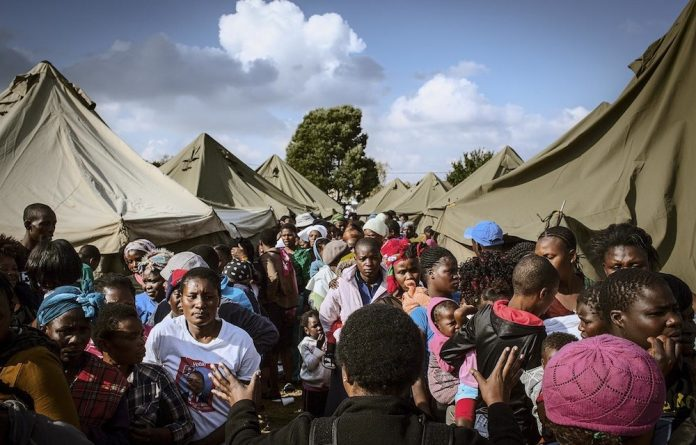 African migrants at a temporary camp of safety in Primrose