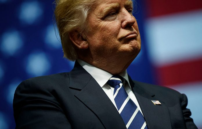 United States president elect Donald Trump says he is not convinced Russia was behind the cyber attacks during the 2016 presidential election.