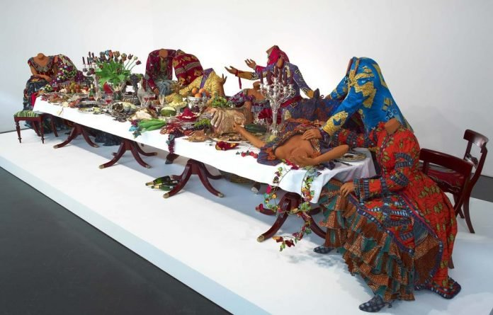 Greed and excess: Yoruba-style batik cloth used in Yinka Shonibare's Last Supper