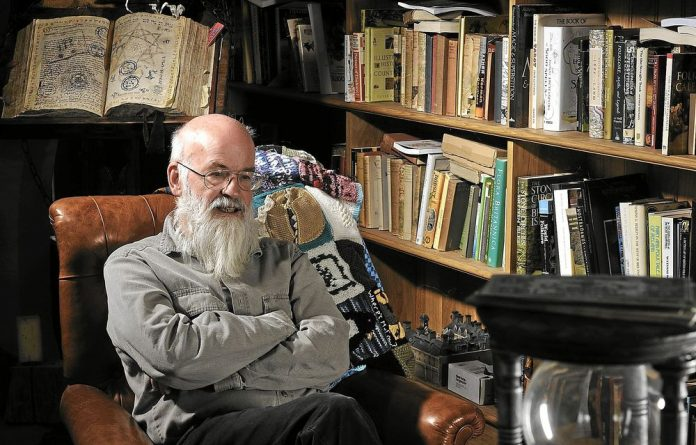 Pratchett world: The author in his library at home in Broadchalke.