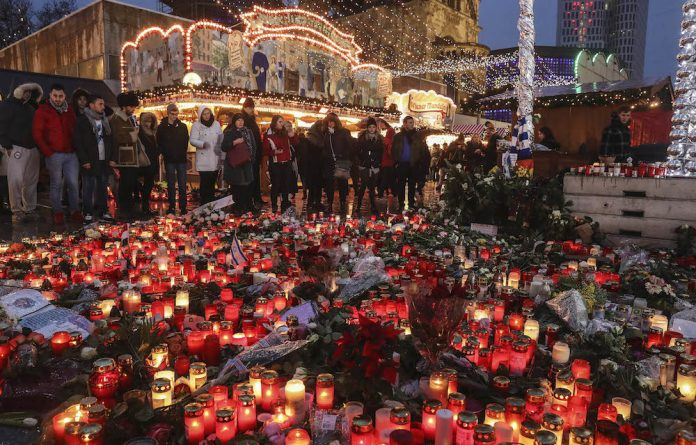 Safe: A memorial in a German market for the 12 killed when a truck ploughed into them. Events such as this are behind a bid for a European security plan — and possibly a defence plan. Photo: Sean Gallup/Getty Images