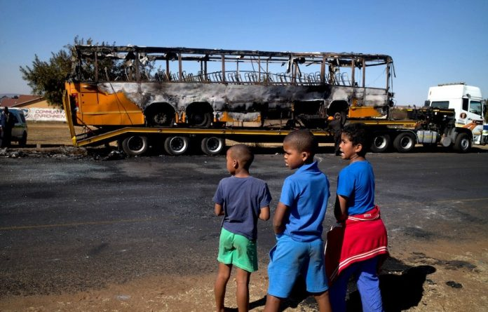 Wheels come off: A Putco bus was burned during the Kliptown West protest action