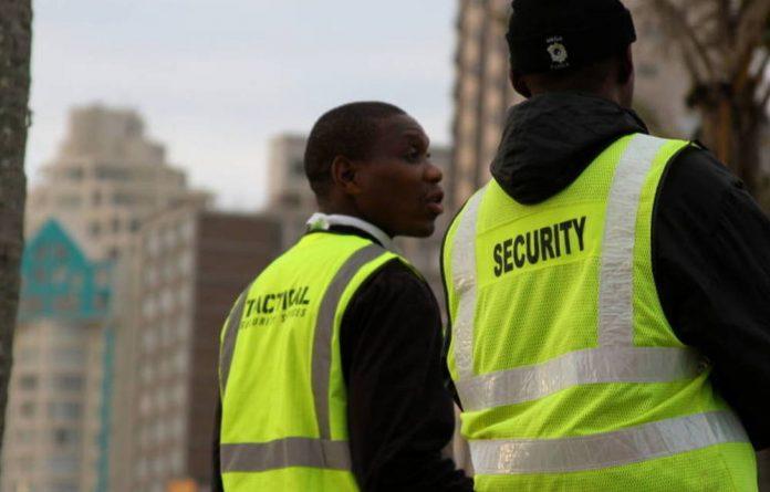 Security personnel keep a lookout on Durban's Addington Beach.