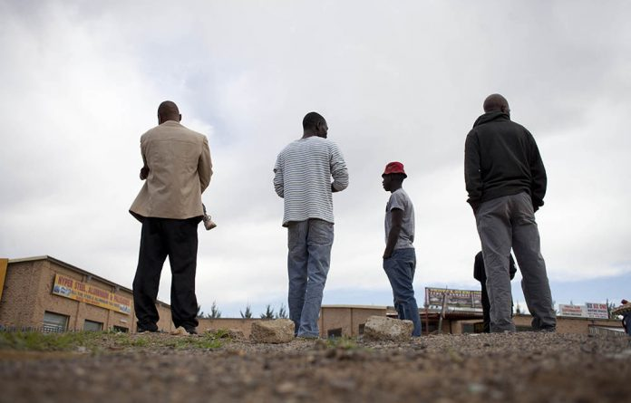 Men looking for work at companies in Protea Glen in Soweto towards the end of last year.
