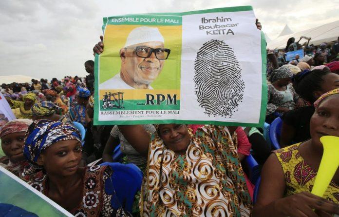 Supporters of Mali's President Ibrahim Boubacar Keita in the capital Bamako. Legnan Koula/EPA/EFE