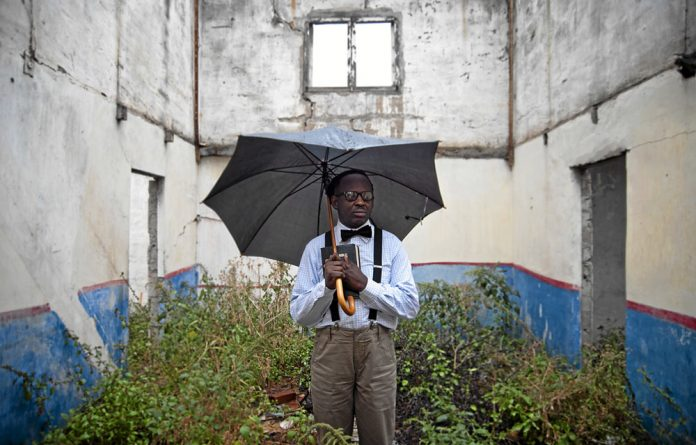 Writer Bongani Madondo in the remains of the family home in Pretoria where he grew up.