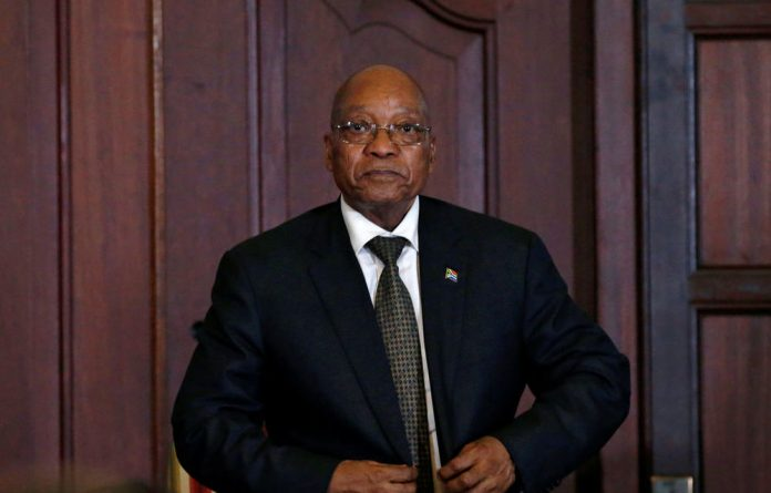 South Africa's President Jacob Zuma looks on as his new cabinet members are sworn in.