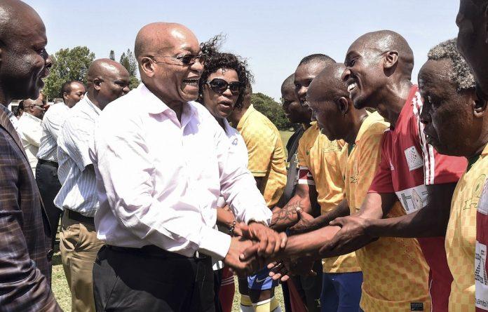 Dudu Myeni and President Jacob Zuma congratulate the Mamelodi Sundowns team after a match in 2014.