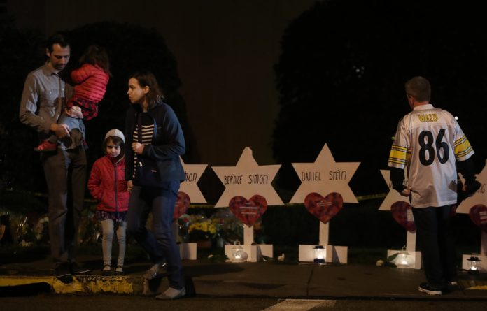 Mourners visit a makeshift memorial outside the Tree of Life synagogue