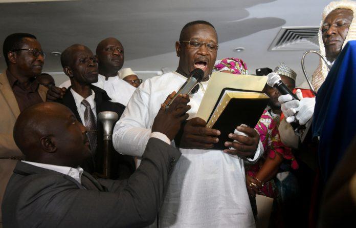 Julius Maada Bio takes his oath as Sierra Leone's new president in Freetown