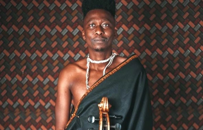 'Glocal': Thokozani Mhlambi explores the links between the music of diverse cultures such as European classical music and Zulu sounds. Photo: Njabulo Magubane. Stylist: Khetha 'ELPPAG' Kweyama