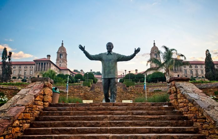 The 11m-high Nelson Mandela sculpture embraces the layout of the Union Buildings.