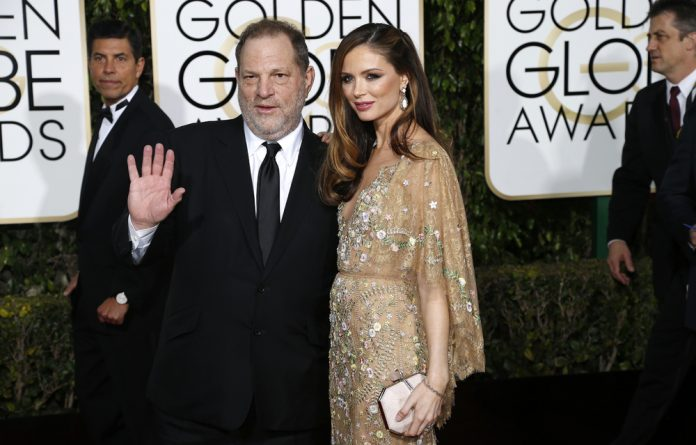 Producer Harvey Weinstein and his wife