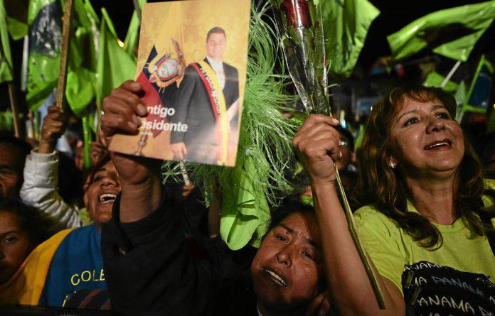 Landslide: Ecuadorian President Rafael Correa's supporters cheer at a rally ahead of his re-election on February 17. Photo: Rodrigo Buendia/AFP