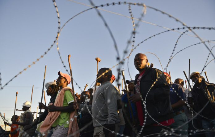 Tension is mounting amid a heavy police and private security presence at Lonmin .