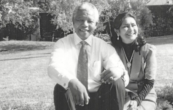 Family and friends: Amina Cachalia with Nelson Mandela at his home in Houghton.